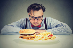 "Stress is one of the biggest contributors to indulging in ""deserving"" high calorie foods either during or after a stressful day. Before heading to the nearest burger joint, try the real hunger test and ask yourself if you would drive through for a healthier meal option. If not, it's more emotional than physical."